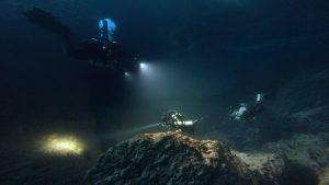 Divers exploring Dwejra underwater