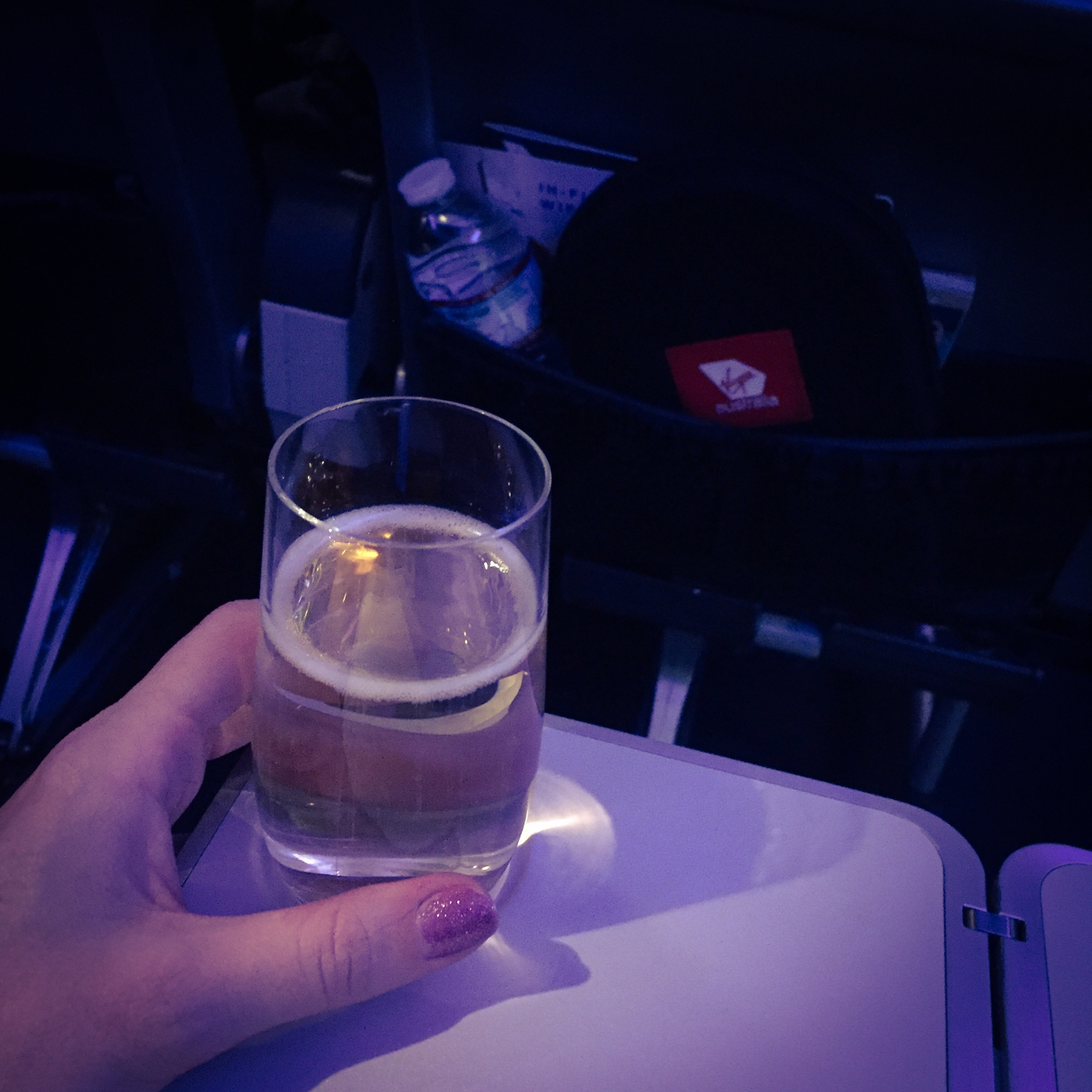 Emigrating to australia celebrate drinks on plane
